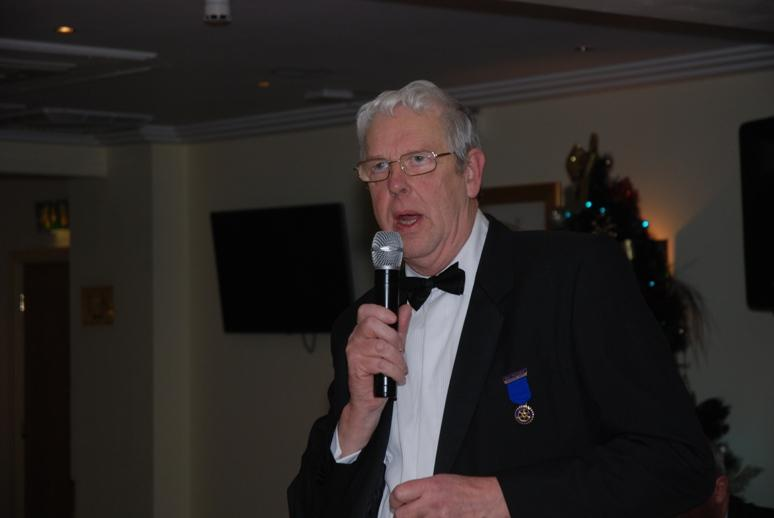 CHARTER DINNER 2015 - Immediate Past President Ron Greenhough proposes to the  toasts to Rotary and Absent Friends