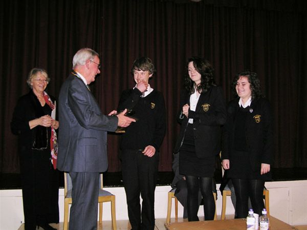 YOUTH SPEAKS 2010 - Rotsry President Bill McDougall congratulates the winning Warriner School Senior team (Grace Phethean, Olli Tindale and Jossie Evans) while senior judge Lesley Cook looks on.