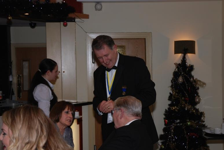 CHARTER DINNER 2015 - In the interval, Colette and Barry catch up with Past District Governor Keith Gledhill.