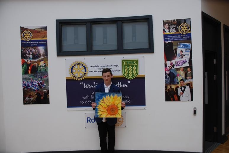 ROTARY YOUNG ARTIST 2015 -2016 - Jay Hooper displaying his artwork in front of Highfield's Rotary Wall.