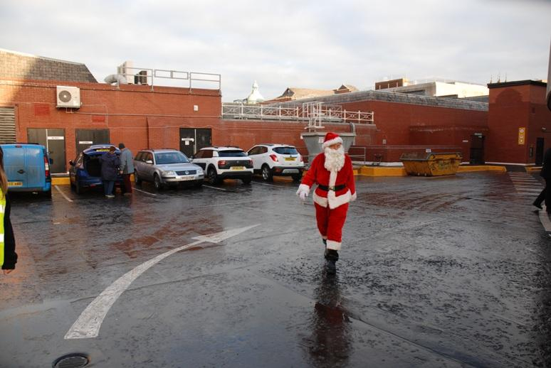 SANTA VISITS THE HOUNDSHILL CENTRE, BLACKPOOL - Santa is walking to the sleigh for the Parade.