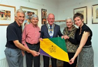 Chippy Jazz 2010 - Mike Howes (organiser, left) with Rotary President Bill McDougall (centre) and Debbie Arthurs (right) show the banner presented by John and Diana Parham who came all the way from New Orleans.