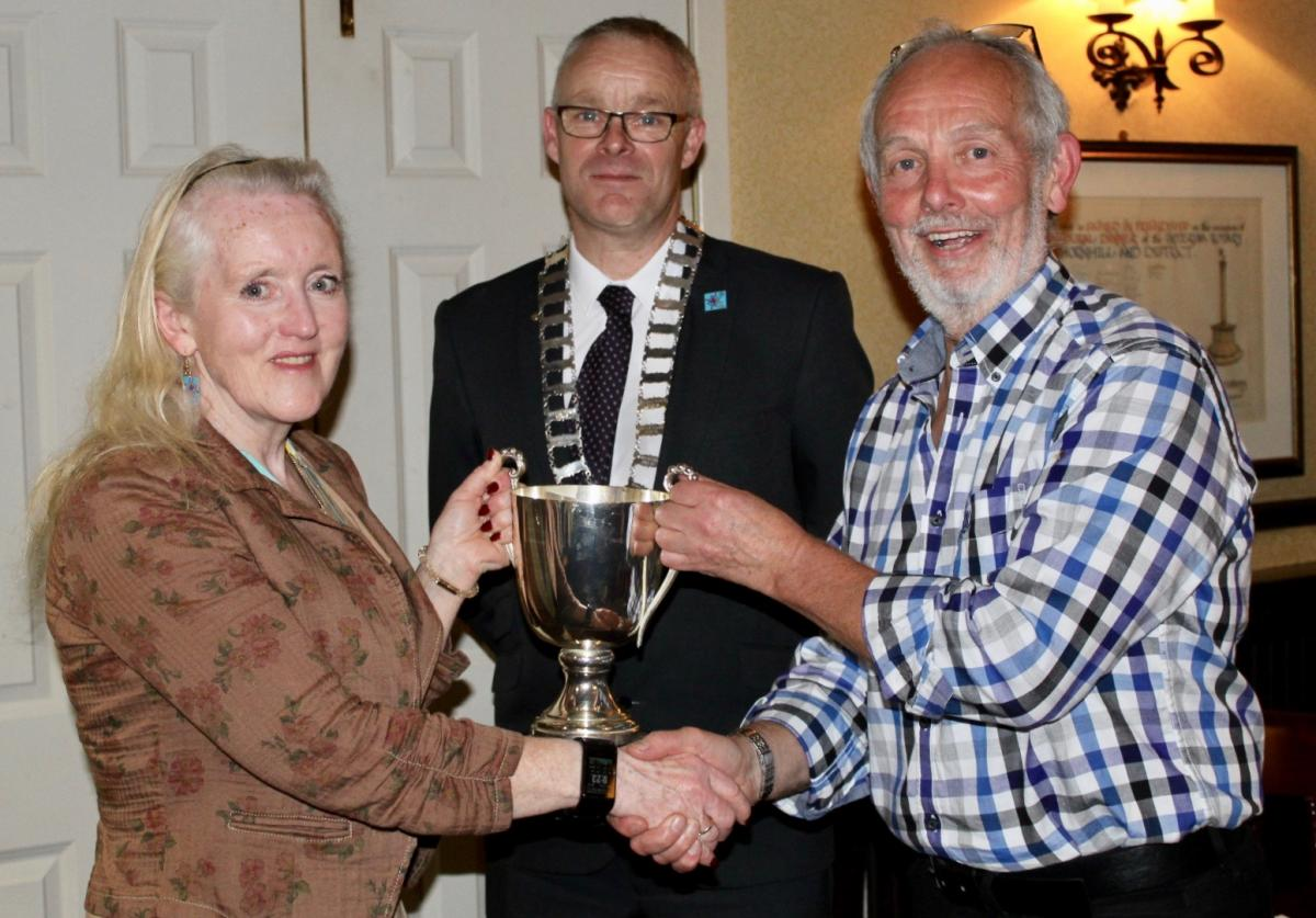 Rotarian Michael Keene Takes Over as President 2019-2020 - Photograph (b) L-R Brenda Waugh (assistant district governor) Michael Keene (president) and Stewart Lee (Secretary)
