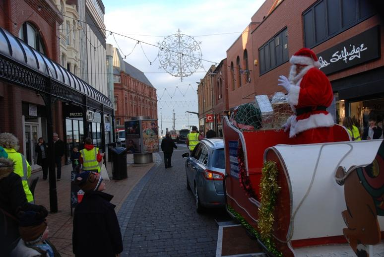 SANTA VISITS THE HOUNDSHILL CENTRE, BLACKPOOL - Santa travelling down Victoria Street.