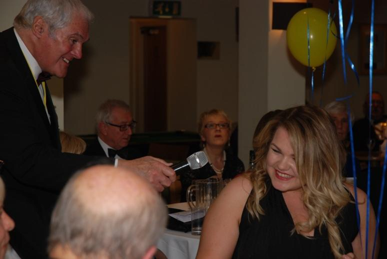 CHARTER DINNER 2015 - Jeff tried to coax Sarah to sing with the microphone.