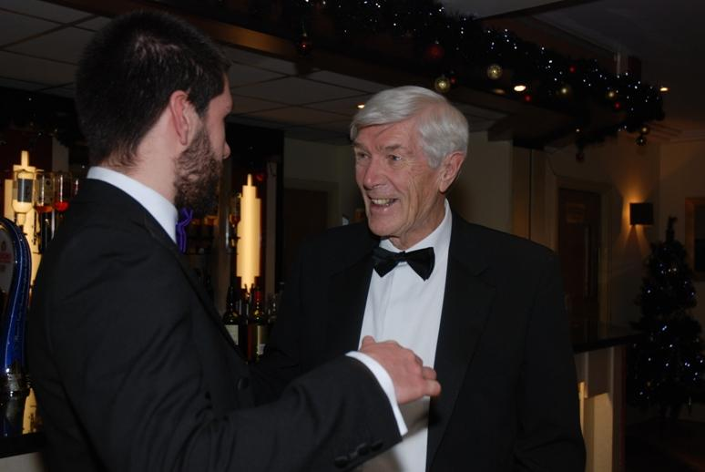 CHARTER DINNER 2015 - Family friend John Bamber chatting to Thomas Meadows.