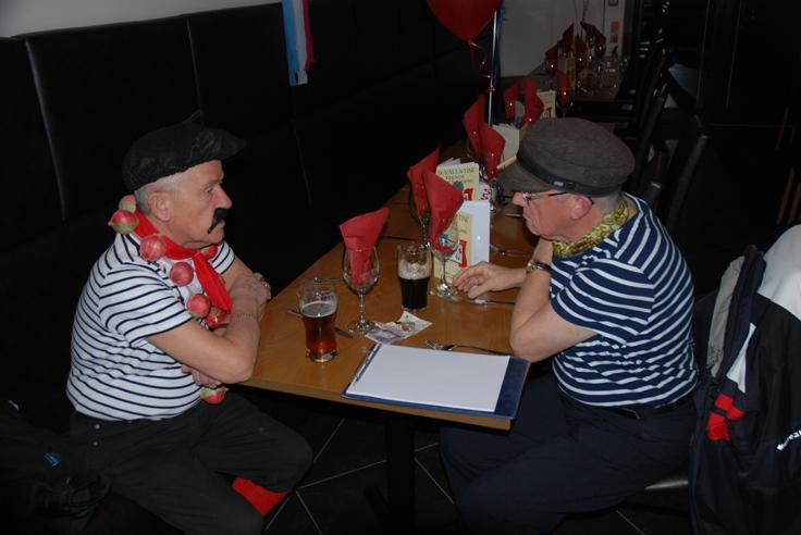 FRENCH THEMED ST VALENTINE DINNER. - Malcolm & Alan discussing who will get the next round in.