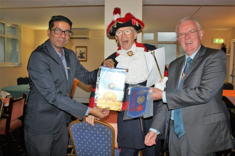 Hospital Consultant from India visits Blackpool South Rotary Club - The exchange of banners.