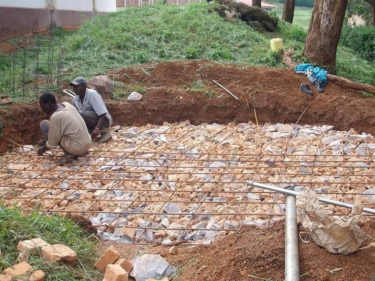 KINKIIZI WATER PROJECT - UGANDA - The hardcore base for a collection tank is laid.