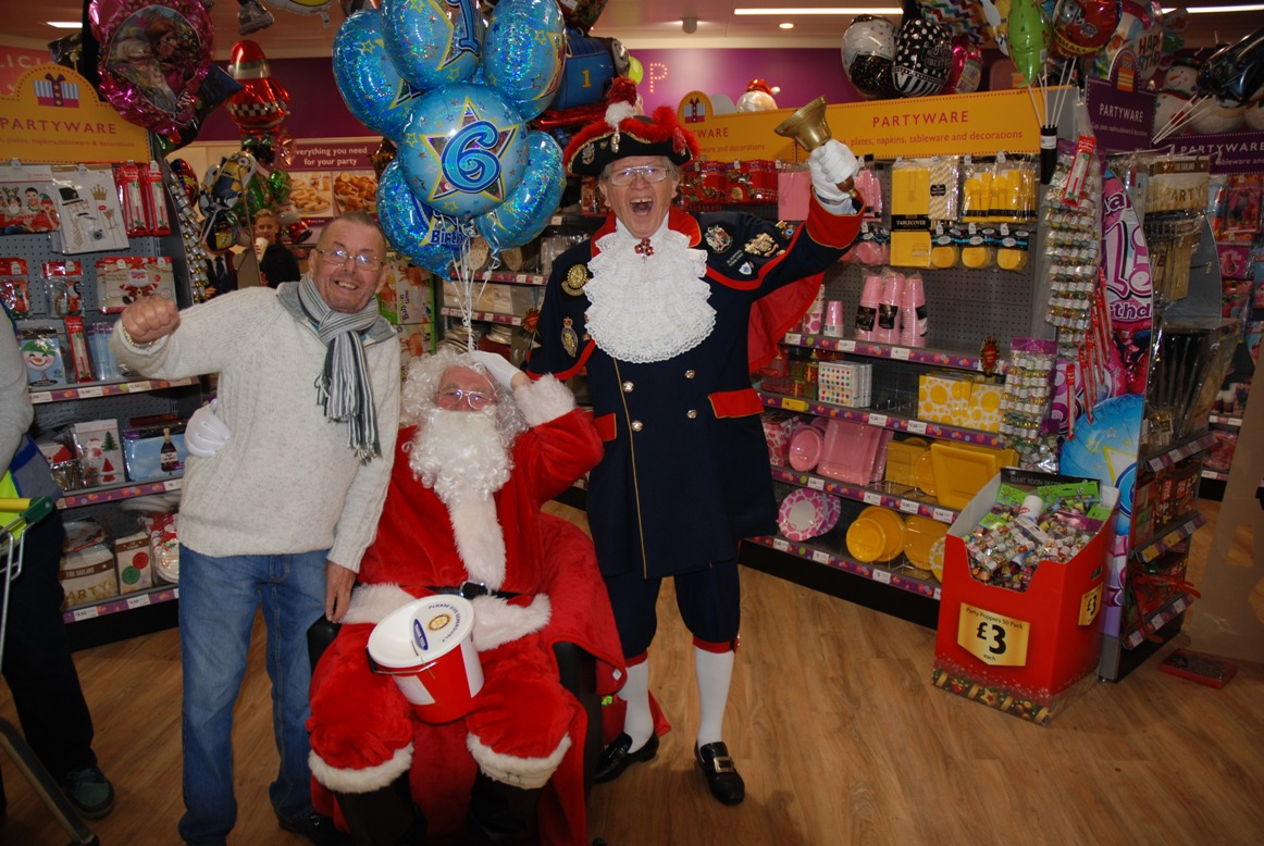 SANTA FUNDRAISING COLLECTIONS - 2018 - A happy customer Lawrie at Morrisons with Santa and Barry.