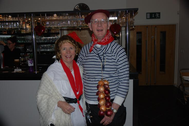 FRENCH THEMED ST VALENTINE DINNER. - Peggy & Bob with his dangly onions.