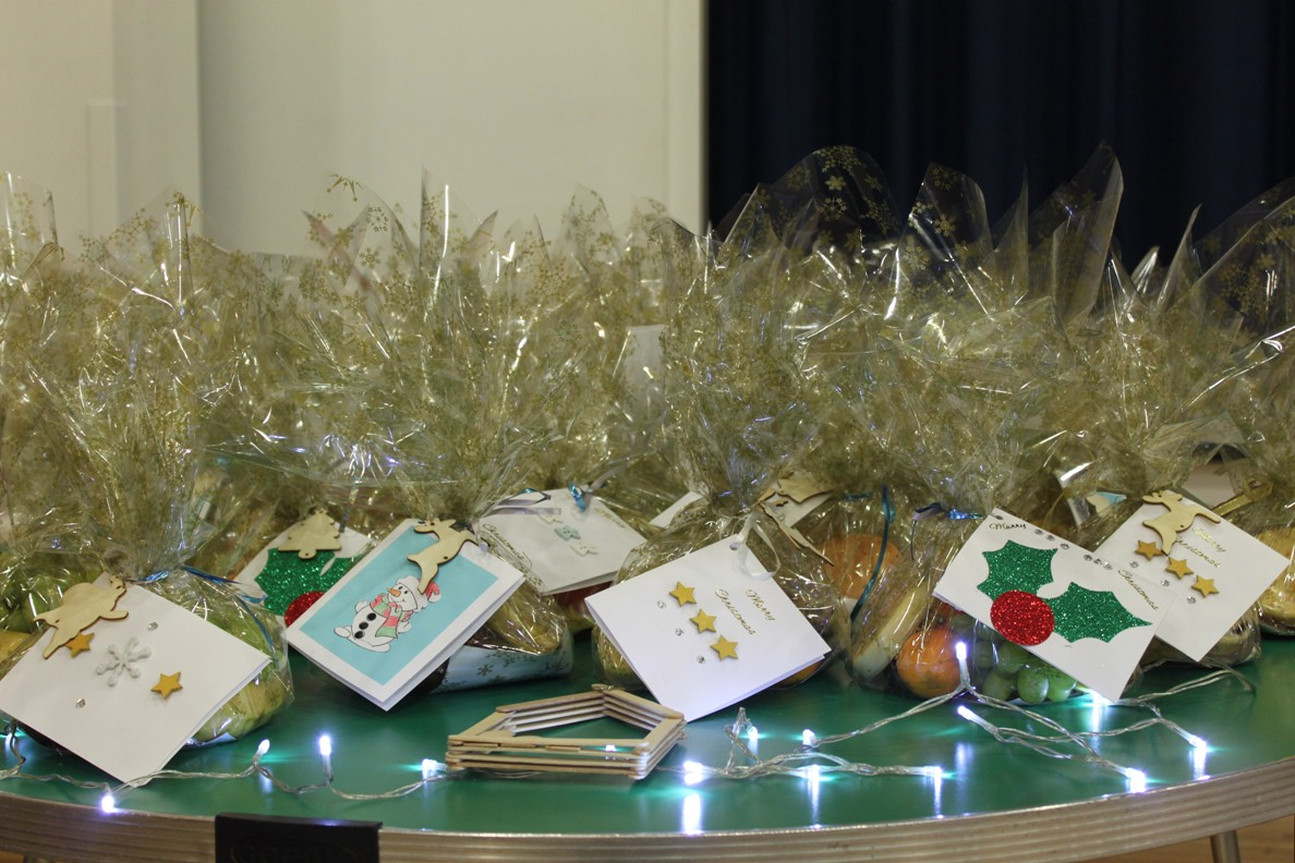 Highfield Leadership Academy Christmas Tea Party for elderly residents. - Each elderly guest received a nice gift when the party finished.