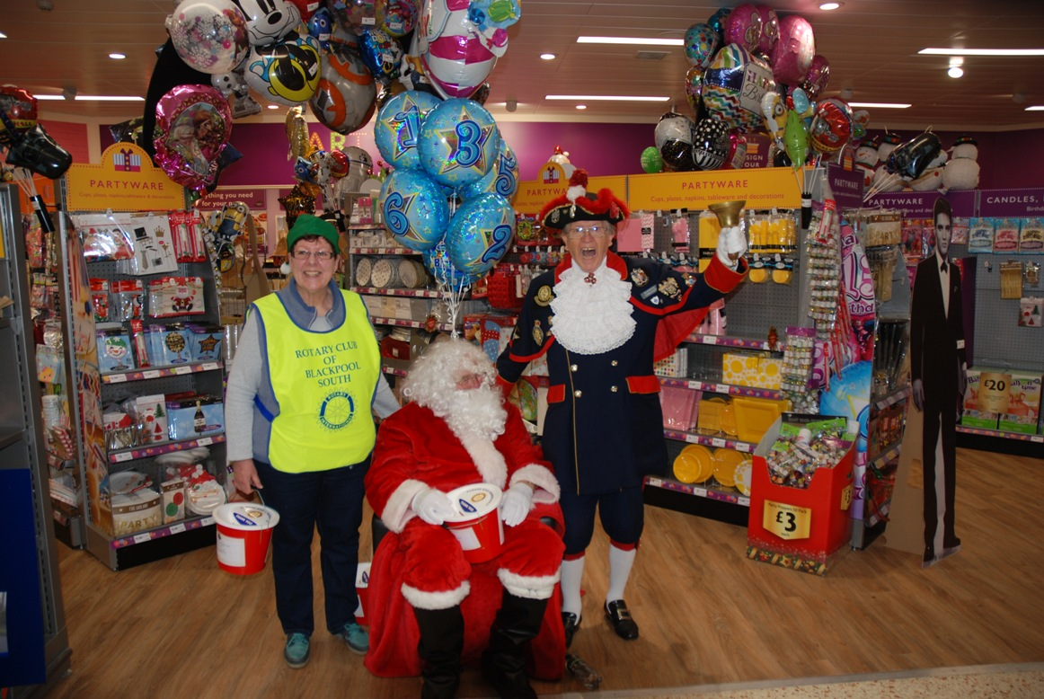 SANTA FUNDRAISING COLLECTIONS - 2018 - Lady Elf Lesley with Santa and Barry.