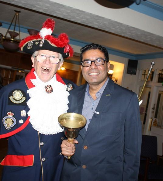 Hospital Consultant from India visits Blackpool South Rotary Club - Dr Tirou takes charge of the bell.