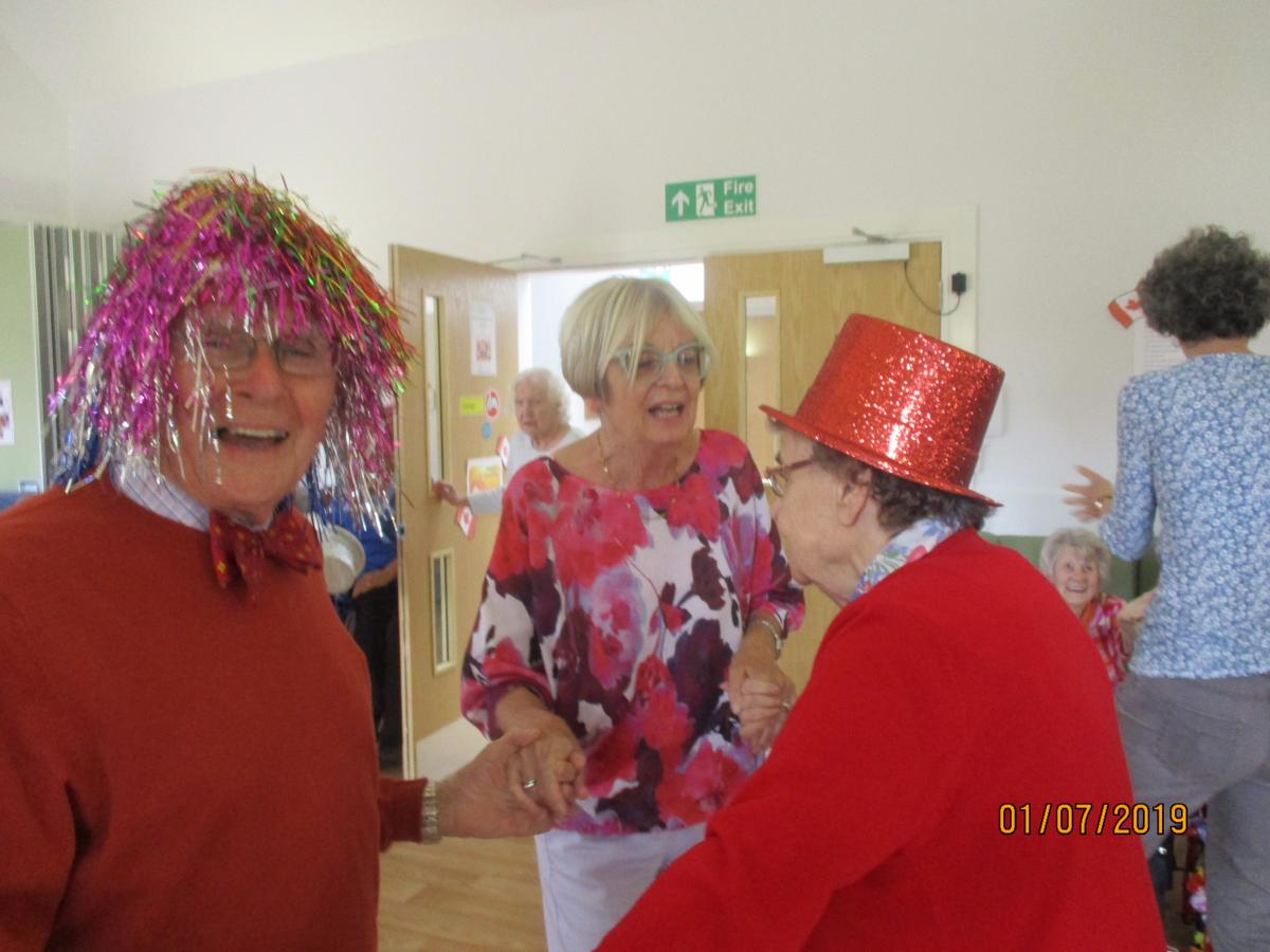 Volunteering in local Care Homes - Rotarians Bobby and Jennifer dancing with the Lady in Red