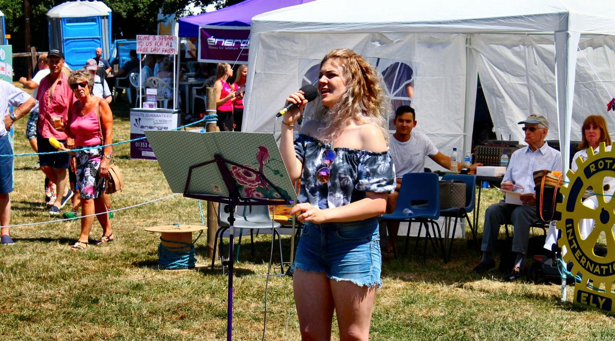 Ely Aquafest 2018 - One of our own members singing for us