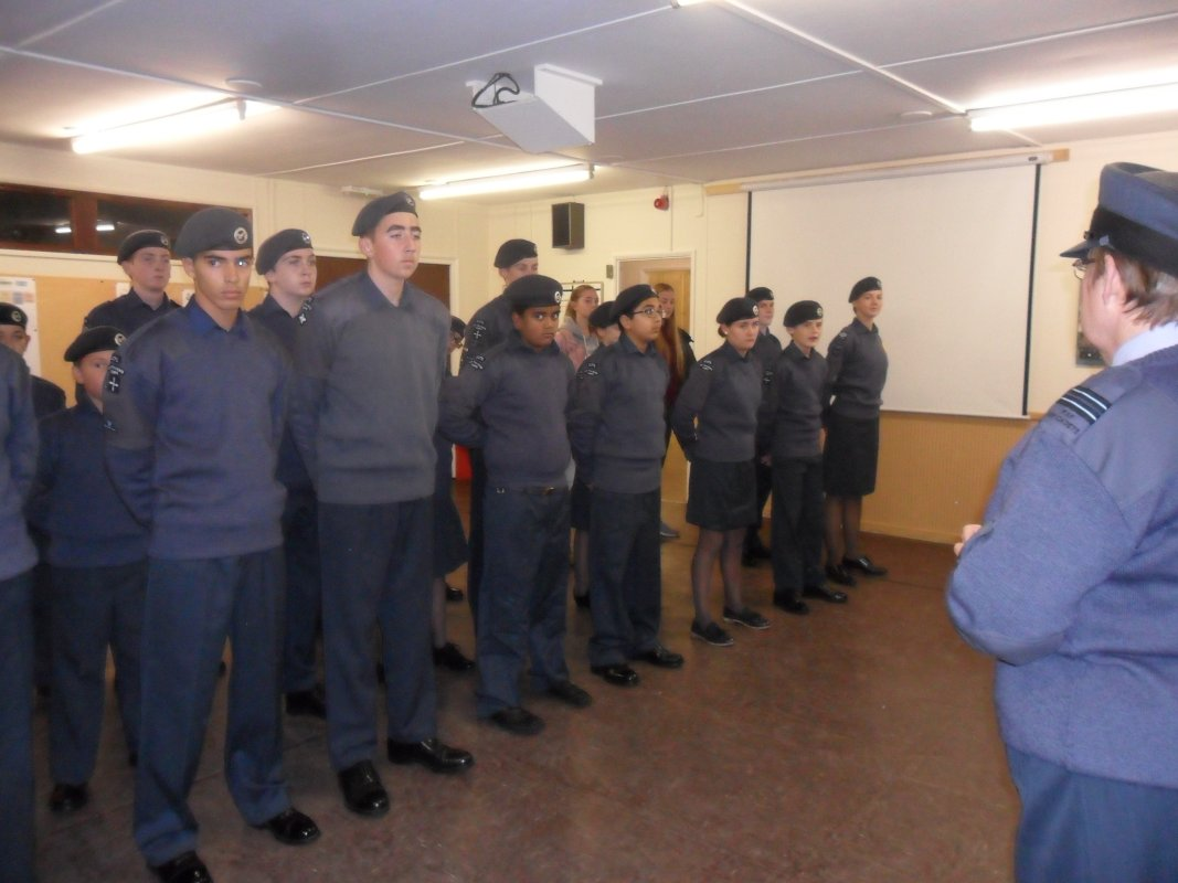 ATC receive our cheque - Flt Lt Claire Penn puts the squadron through their drill