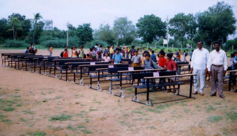The Schools Project in Chickjajur  District in Karnataka-India - Staff and students receiving the desks & chairs