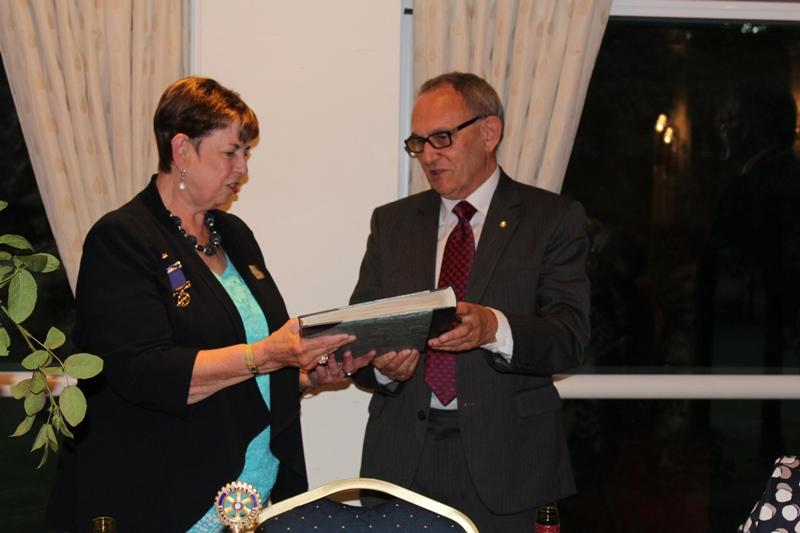 Ross Rotary Club Handover Dinner - Alan presents PP Tina with her album of her year