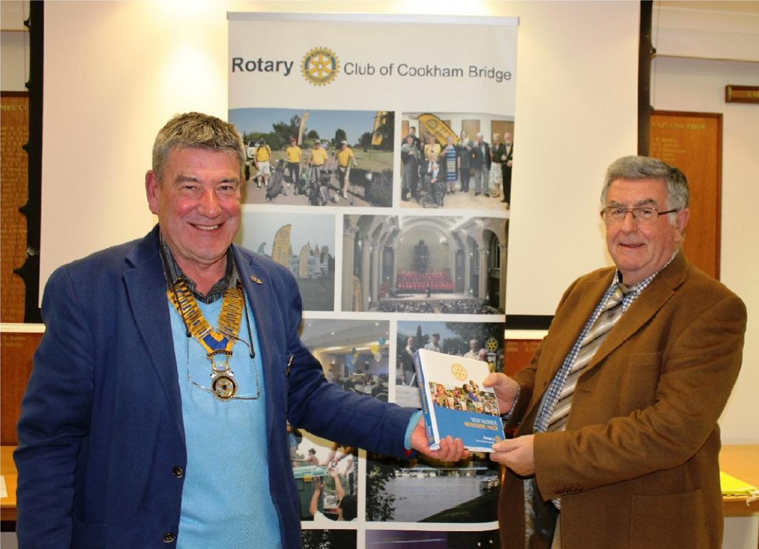 PR & Membership - New member Andrew Richards is welcomed to the Club by president Chris