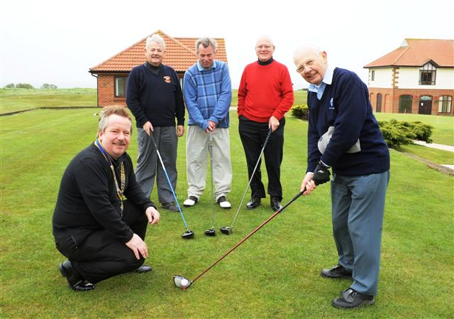 2012 Annual Charity Golf Competition - Organiser Harry Barnett shows the President how