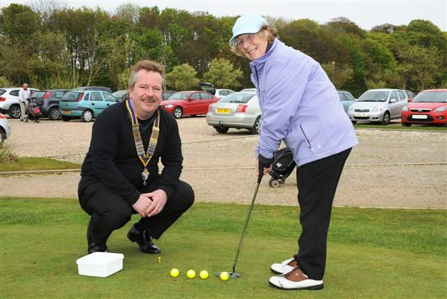 2012 Annual Charity Golf Competition - Etta Deamer has a few putts