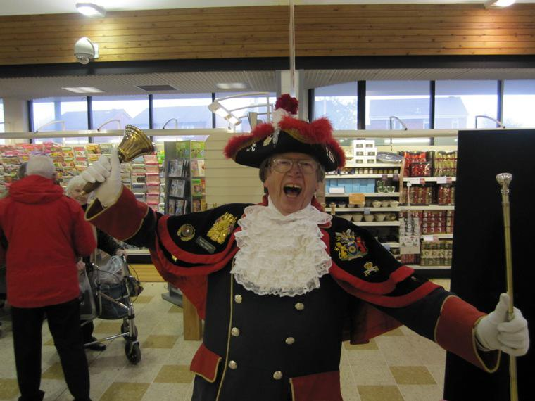 SANTA AND THE MUSICAL SANTA SLEIGH VISITS THE MARTON BOOTHS STORE  - Town Crier Barry McQueen proclaiming his arrival at the Store.