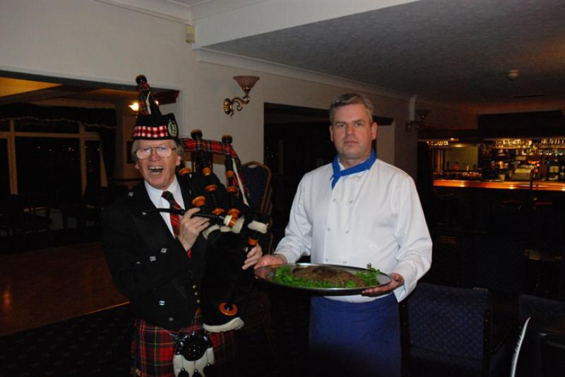 BURNS NIGHT - Barry leading Chef in with the haggis.