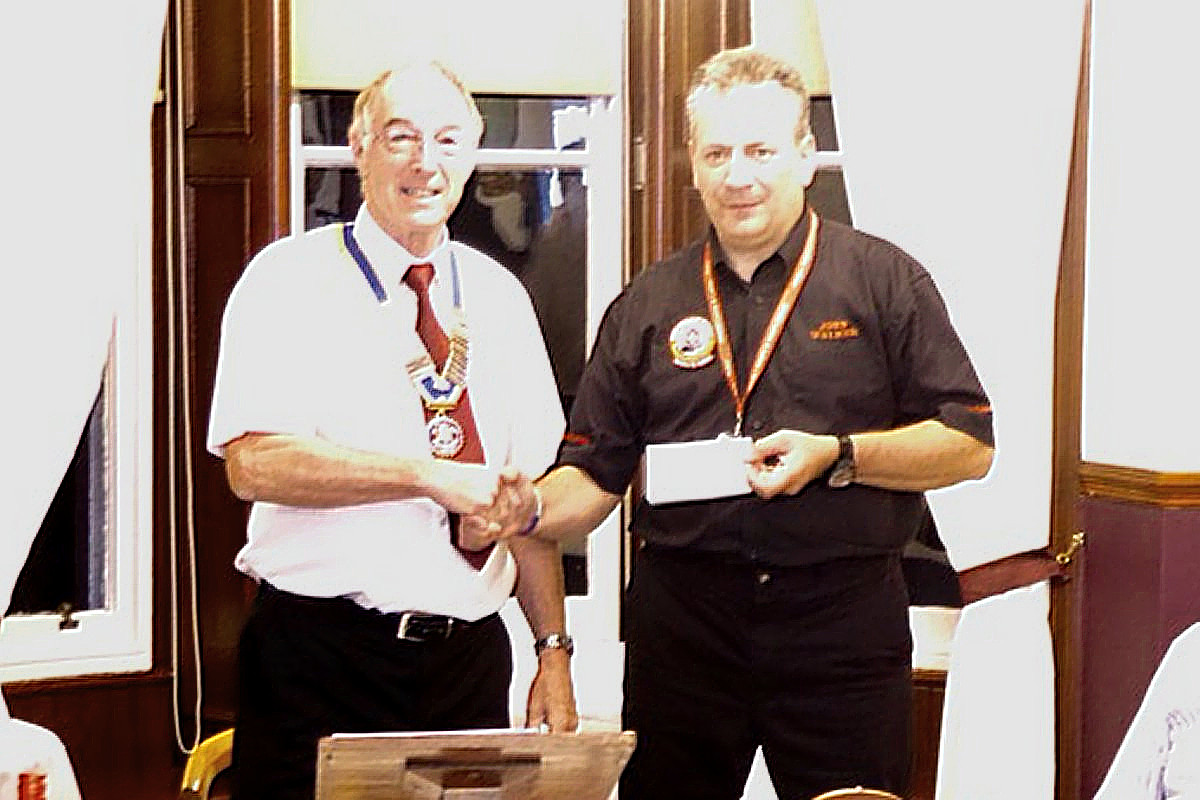 Blood Bikes - President David presents a cheque to John for £200