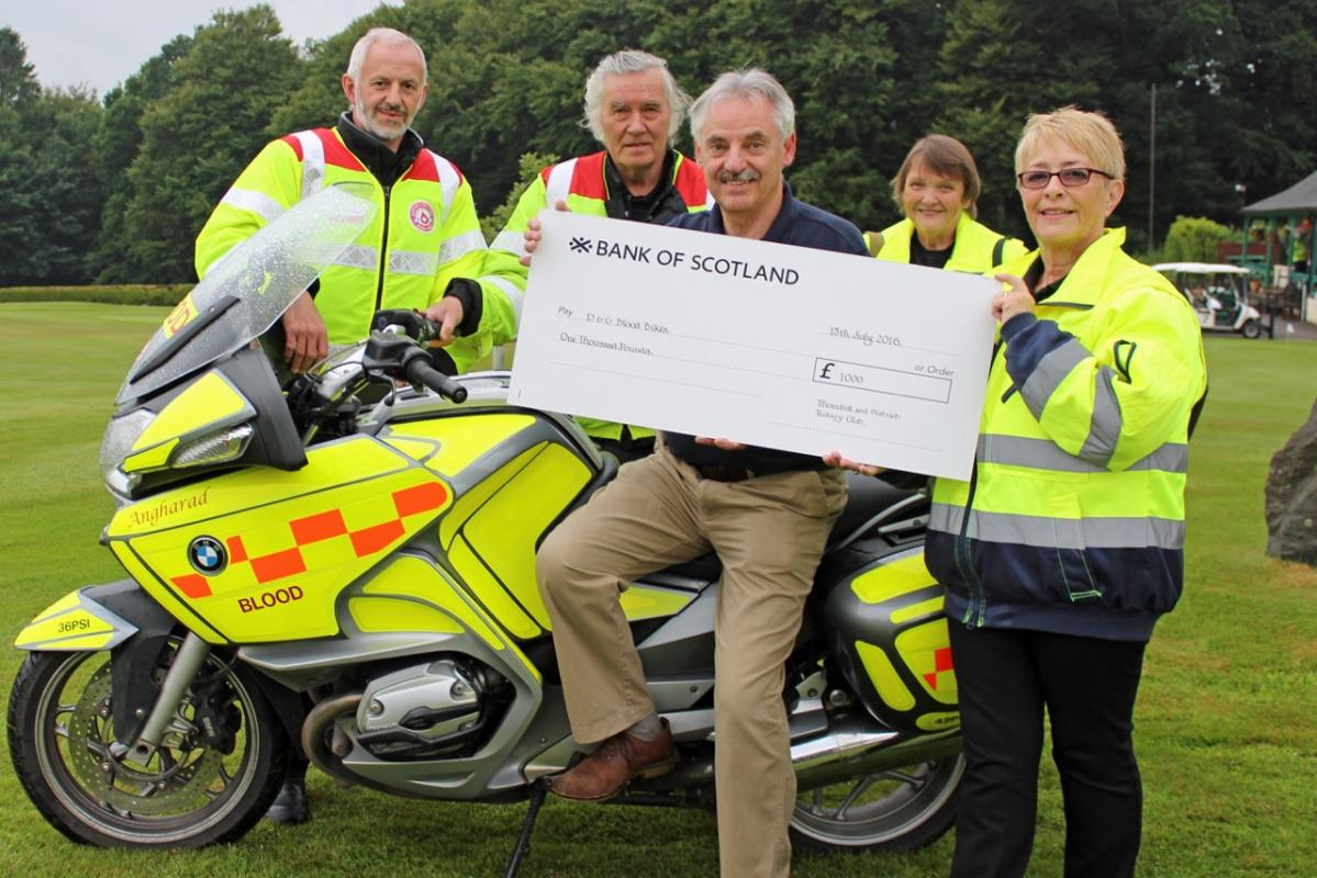 D & G Charities Benefit from 2016 Am/Am  - Picture shows Dumfries and Galloway Blood Bikes Vice – Chair Judith Sauberlich receiving the cheque from Thornhill Rotary President Ian Morrison.