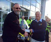 Blood Bikes - Immediate Past President, Patrick Mcginley is seen handing over a cheque for £600 from our club.