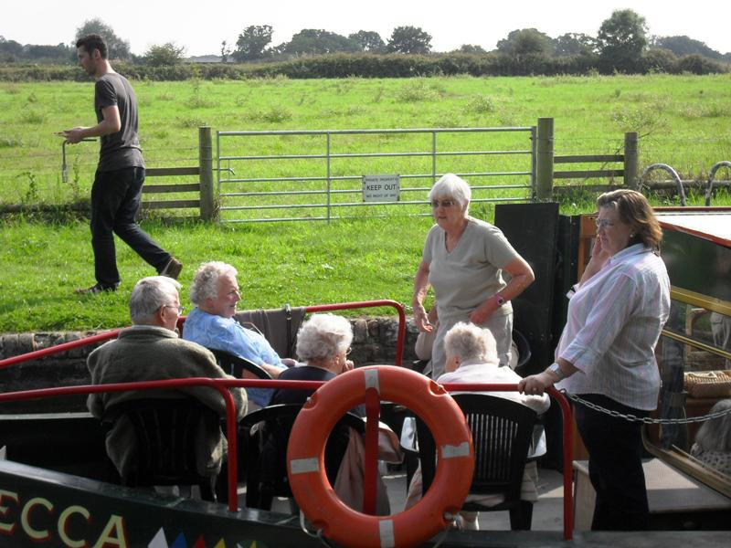Kintbury Volunteer Group  Barge Trip 2014 - on the bow with Rotarian Irene.