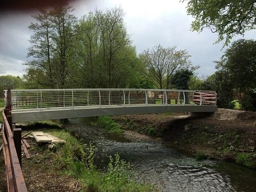 St Catherines Hospice Footbridge Construction - Bridge secured and awaiting completion of the linking paths to the main Hospice grounds
