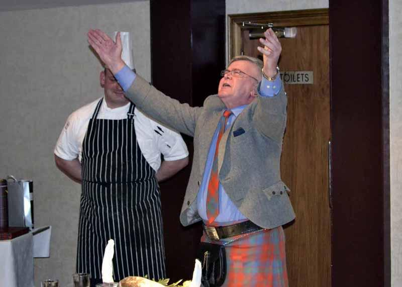 What we do for fun - Alastair Robertson addressing the haggis