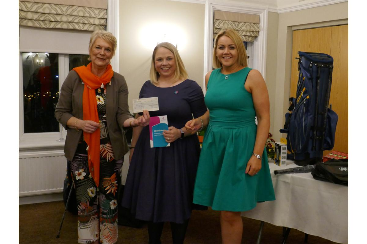 Bus Am Golf Tournament - President Patricia presents a cheque to Claire Ellis from Dementia UK.