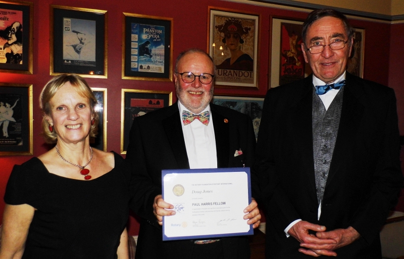 2016 Presidents' Evening Christmas Party at The Old Hall - Buxton Rotarian Doug Jones (centre) receives PHF from Co-Presidents Kath Silson and Andrew Matthews