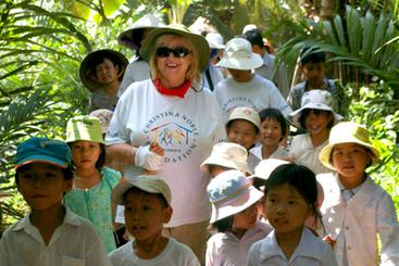 Our supported charities  - Christina Noble with some of the children supported in Vietnam