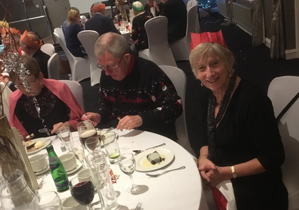 Festive Evening - Jennifer has an eye for the camera while Past President IAN has his on the Christmas Pudd