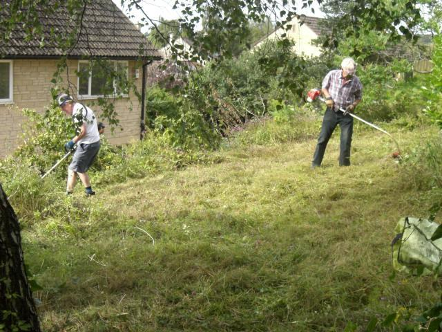 Gardening at Peggy Dodds - The petrol strimmers easily take care of the overgrown grass.