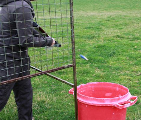 Annual Clay Pigeon Shoot - ... and ejects the cartridge.