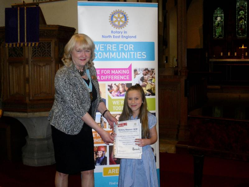 Young Musician 2015 - District Final - Caitlin Bannister, runner-up in the vocalist category, receives her certificate from DG Jean Thompson