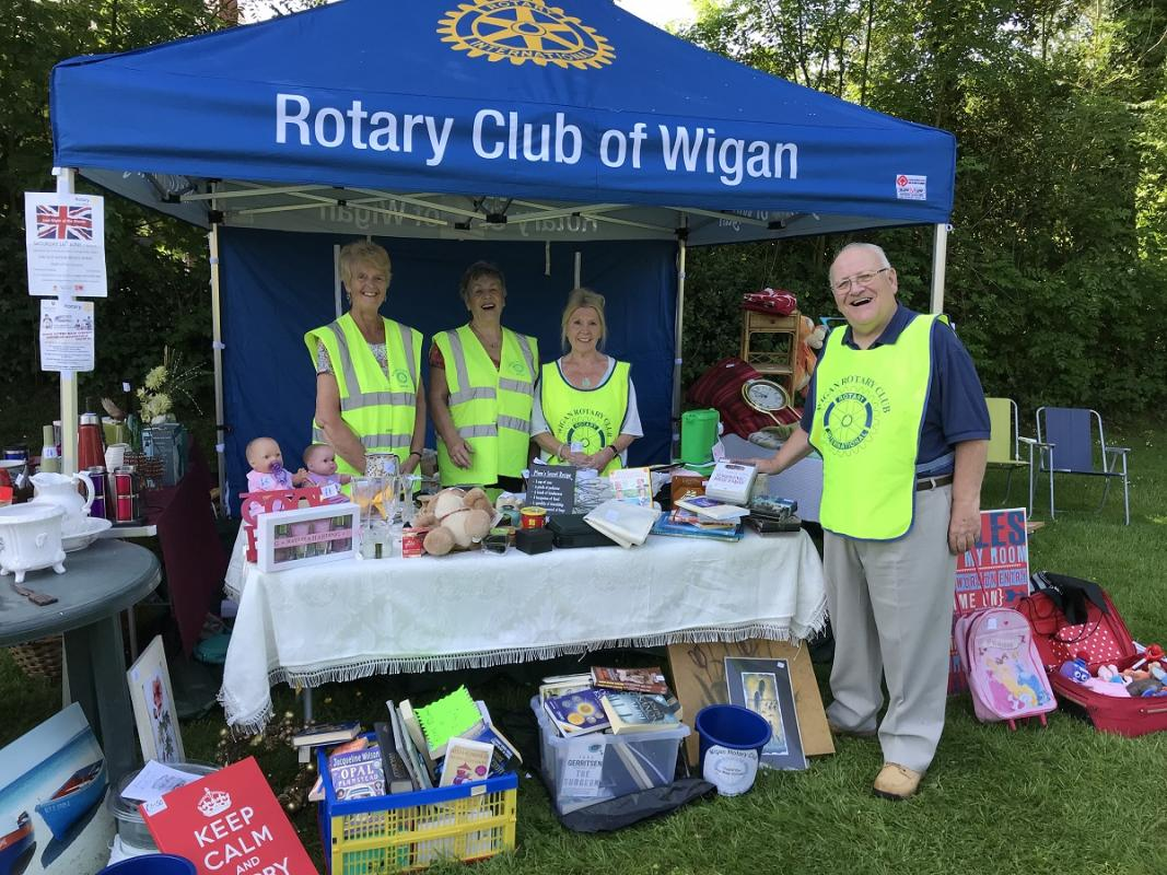 Latest news from the Wigan Rotary Club - Rotarian at a car boot sale