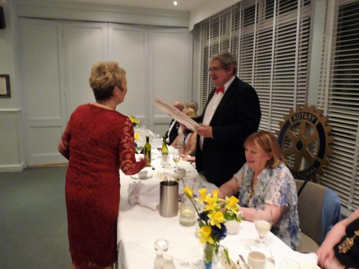 Club Celebration Evening - Rotarian Denise Whetton makes a presentation of a framed picture to Rev'd David Garnett