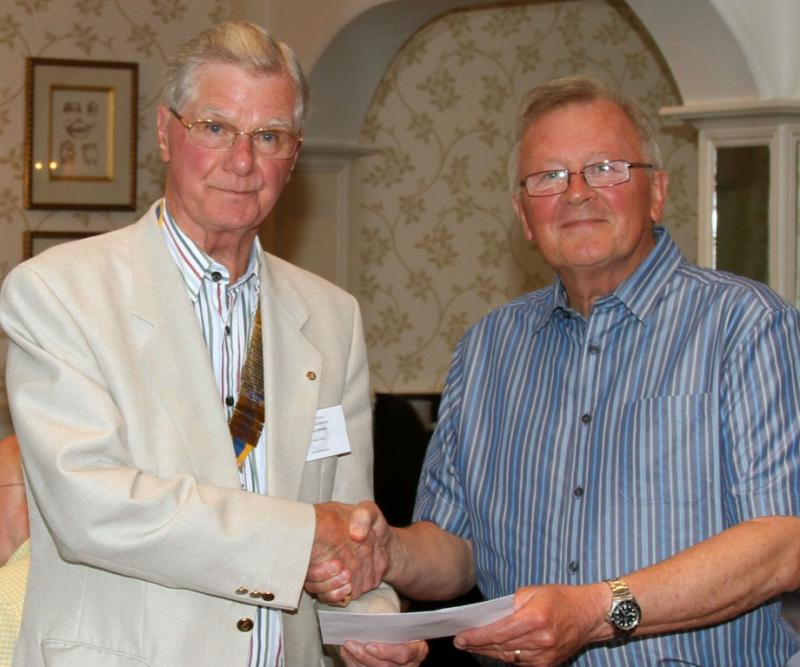 HORSE OR CYCLE OR WALK. OUR MAJOR EVENT OF THE YEAR. - Charles Fay receives a cheque on behalf of the charity.
