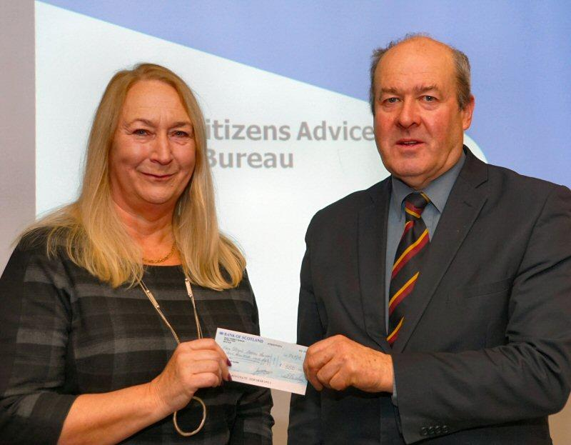 Sports, Social and Events - Local manager, Gill Maclean receiving a cheque from Rotary President Laurie Fraser
