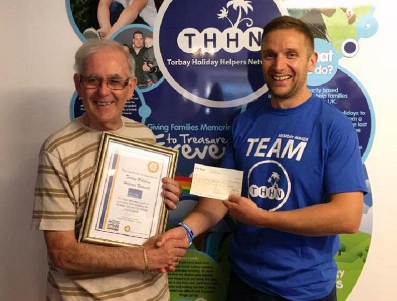 Supporting THHN - Terry Moylan,  handing over cheque and certificate to Luke Tillen, founder of THHN.
