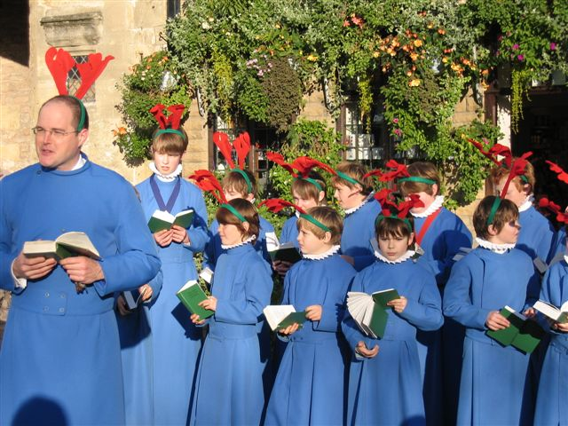 Reindeer Parade Photos -  Wells Cathedral Boy Choristers, under the direction of Matthew Owens, singing carols in the Market Place.