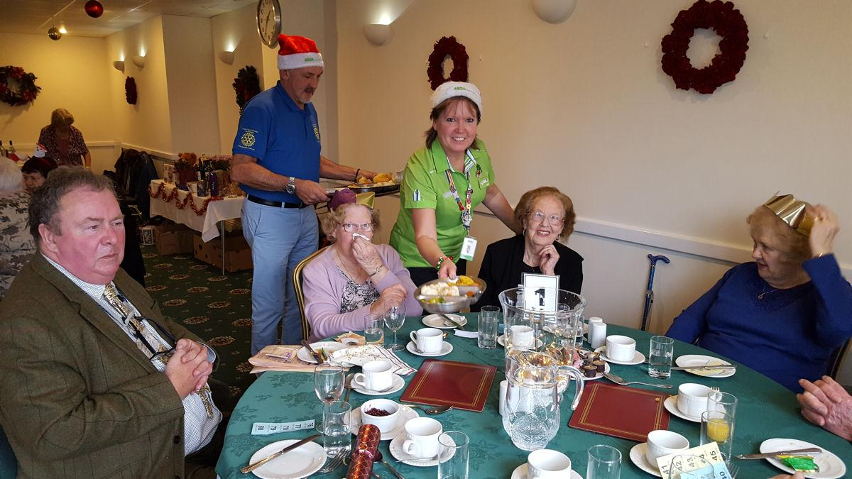 Shanklin Rotary Club Hosts Senior Citizen Christmas Lunch - Clare Jones from Asda helps serve the guests