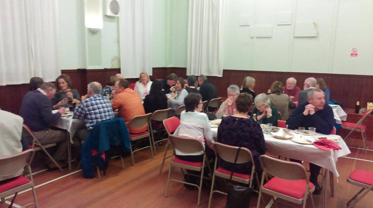 Recent Club Activities - Raising funds at a Curry Night in Nethy Bridge