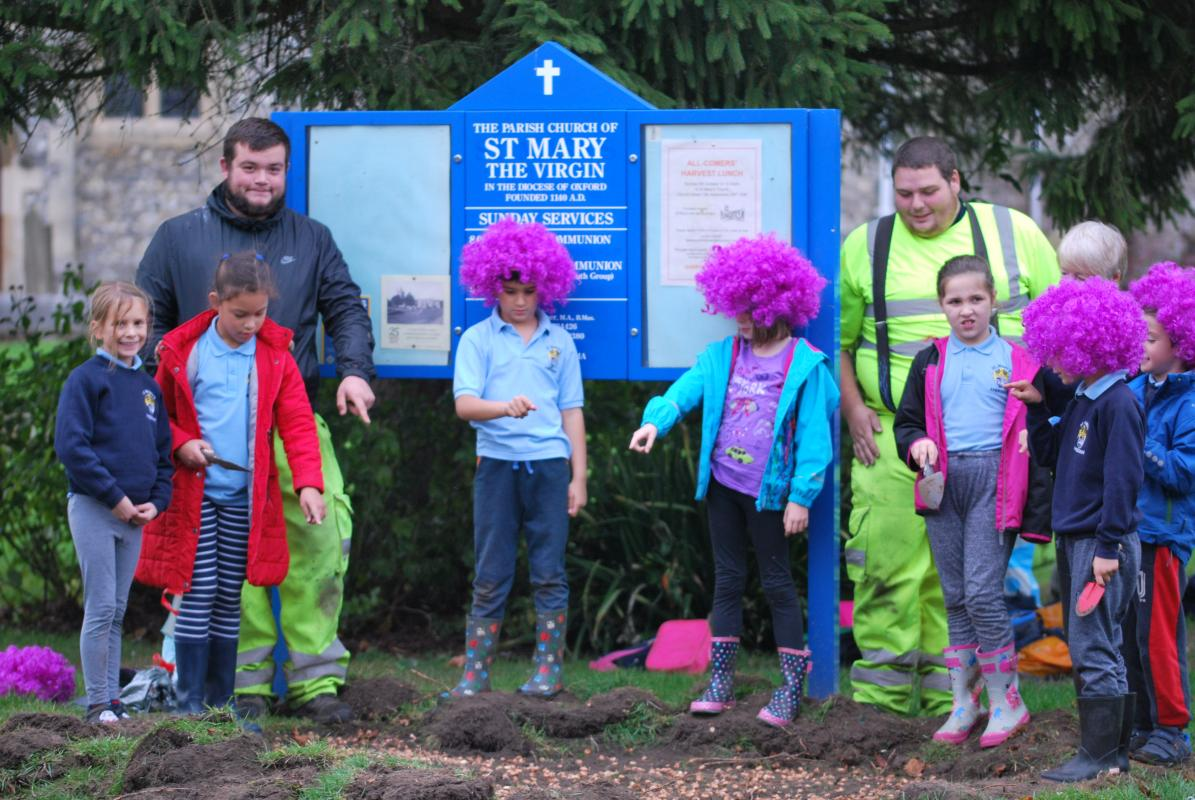 Purple Planting in Amersham -  Steve Catanach - Amersham Town Clerk and staff member mobilise pupils from St Mary's School to plant purple Crocuses on behalf of the Purple4Polio Campaign